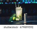 mojito cocktail on the bar. rum ... | Shutterstock . vector #679899592