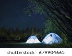 camping tents illuminated at... | Shutterstock . vector #679904665