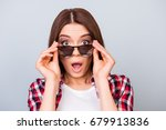 cute amazed brunette girl... | Shutterstock . vector #679913836