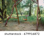 a wooden swing in the park. eco ... | Shutterstock . vector #679916872