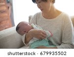 asian grandmother and her... | Shutterstock . vector #679935502