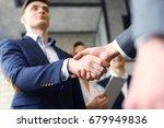 business people shaking hands ... | Shutterstock . vector #679949836