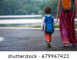 a child with a backpack walks... | Shutterstock . vector #679967422