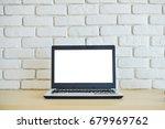 laptop computer on wood desk... | Shutterstock . vector #679969762