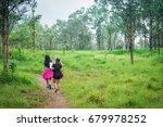 traveller friends hiking in the ... | Shutterstock . vector #679978252