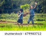 asian children farmer on rice... | Shutterstock . vector #679983712