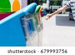 woman hand putting used paper... | Shutterstock . vector #679993756