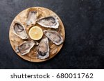 opened oysters  ice and lemon... | Shutterstock . vector #680011762