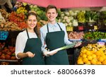 young russian workers selling... | Shutterstock . vector #680066398