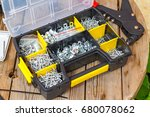 Small photo of Rivet tool and rivets of various sizes in the storage box