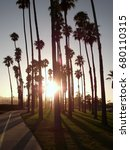 sunset through the palm trees... | Shutterstock . vector #680110315