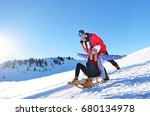 young couple sledding and... | Shutterstock . vector #680134978