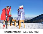 a couple is resting on lounges... | Shutterstock . vector #680137702