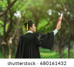 Graduate Put His Hands Up And...