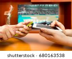 friends using mobile phone and...   Shutterstock . vector #680163538