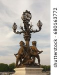 Small photo of Sculpture on the Bridge of Alexander III in Paris