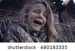 Small photo of A hungry homeless child cries. War.