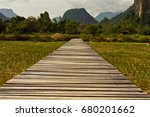 wood road into the natue | Shutterstock . vector #680201662