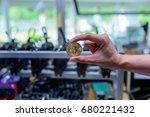 man's hand holding golden... | Shutterstock . vector #680221432