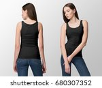 Black tank top on a young woman ...
