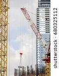 tower construction crane moves... | Shutterstock . vector #680325112