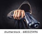 faceless man with a pistol   Shutterstock . vector #680325496