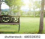 Wooden Bench In The Peaceful...