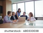 business people discussing at... | Shutterstock . vector #680333038
