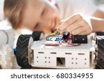 little boy holding wires of... | Shutterstock . vector #680334955