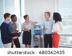 young coworkers discussing... | Shutterstock . vector #680362435