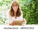 shot of a happy middle aged... | Shutterstock . vector #680421562