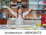 cheerful little girl cooking... | Shutterstock . vector #680428372