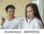 Small photo of Upset wife girl and her husband try to talk Man reconciled to angry girl hope Forgive him.