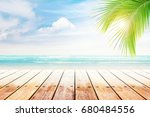 empty wooden table and palm... | Shutterstock . vector #680484556