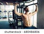 young bodybuilder training in... | Shutterstock . vector #680486806