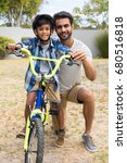 portrait of father and son on... | Shutterstock . vector #680516818