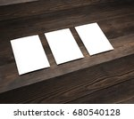 empty white paper on wooden... | Shutterstock . vector #680540128