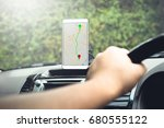 man sitting in the car use... | Shutterstock . vector #680555122