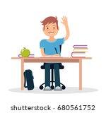 schoolboy in classroom sitting... | Shutterstock .eps vector #680561752