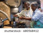 smiling senior couple preparing ... | Shutterstock . vector #680568412
