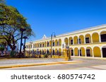 yellow colonial building in... | Shutterstock . vector #680574742