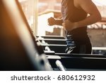 man running in a modern gym on... | Shutterstock . vector #680612932