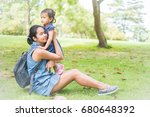 asian mother and daughter in... | Shutterstock . vector #680648392