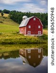 red barn with pond reflection | Shutterstock . vector #680650948
