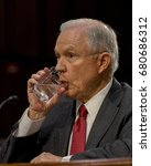 Small photo of US. Attorney General Jeff Sessions pauses for a drink of water before giving response to a question from members of the Senate Intelligence Committee during his testimony Washington DC, June 13, 2017