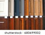 Stock photo wood cabinet door samples in market in a row 680699002