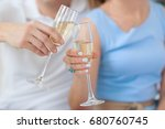 glasses of champagne in hands | Shutterstock . vector #680760745