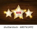 retro light sign. three gold... | Shutterstock . vector #680761492