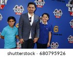 Small photo of LOS ANGELES - JUL 8: Larry Hernandez, children at the Marvel Universe Live Red Carpet at the Staples Center on July 8, 2017 in Los Angeles, CA