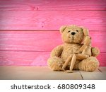 wooden puppet with a teddy bear ... | Shutterstock . vector #680809348